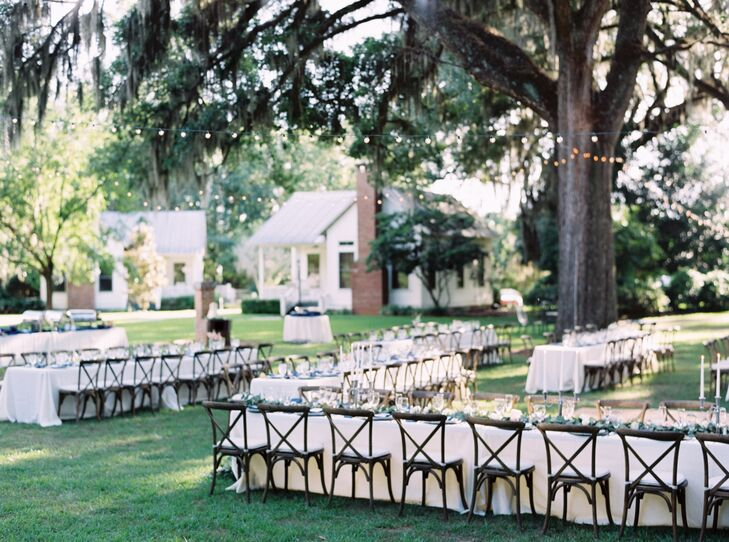 The coordinators at Shannon Reeves Events took care of making the reception look exactly as they envisioned it: a family garden party. Dark wooden chairs lined every family-style table, while string lighting was hung from above to give it a romantic and casual feel.