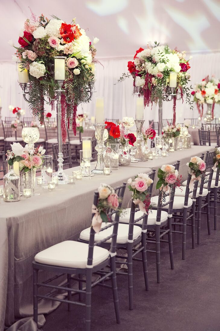 The reception tables featured a mix of high and low centerpiece decor, as well as charming candle votives.