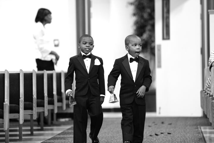 The two ring bearers walked down the aisle during the ceremony, wearing black tuxedos with matching black bow ties.