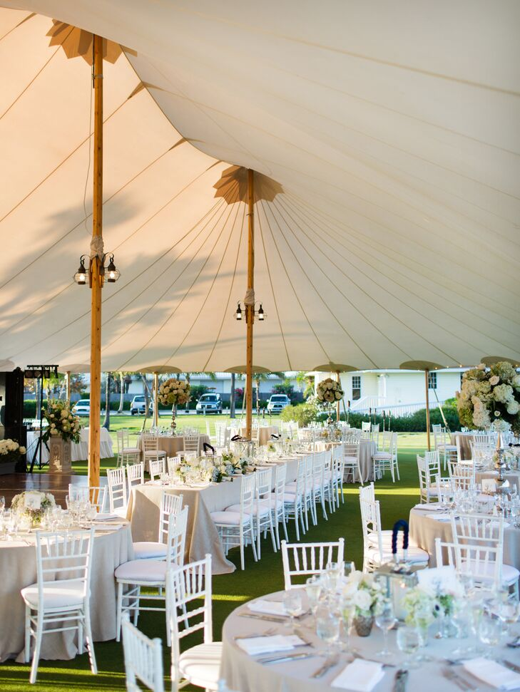 The reception was held outdoors on the Croquet Lawn of  Gasparilla Inn & Club, under a large, white tent.