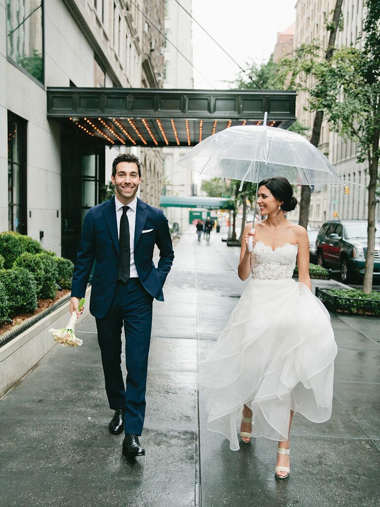 bride and groom city wedding in the rain