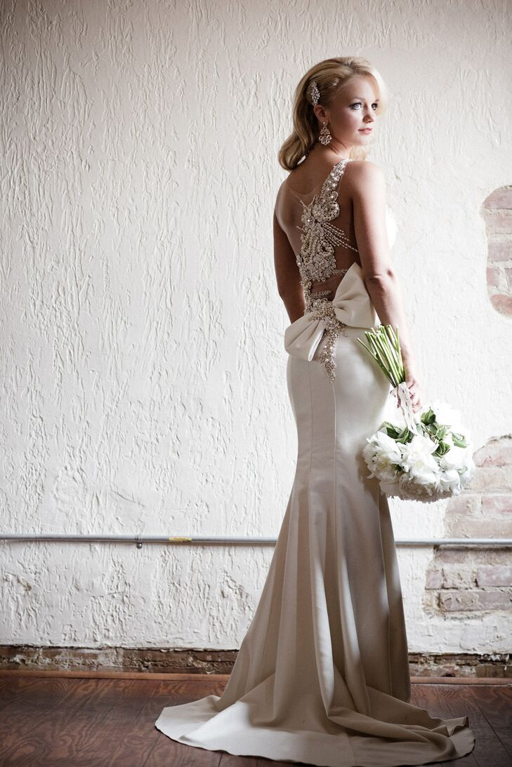 Shelby wore a Tarik Ediz sheath white silk wedding dress. The open back was decorated with extravagant beadwork of crystals and pearls. She completed her look with Kate Spade earrings and a crystal hair accessory from Etsy.