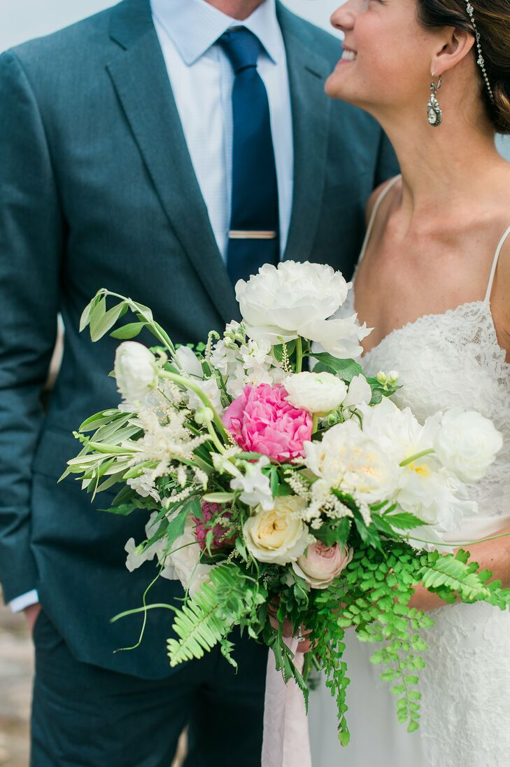 Lauren gave her florist Watershed Floral full reign when it came to her bouquet. Capturing the natural essence of the day, the team put together a stunning arrangement of roses, ranunculuses, peonies and ferns with an untamed, romantic appeal.