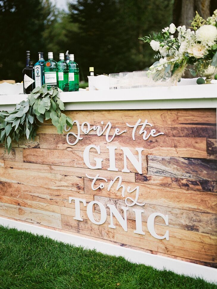 Rustic Wooden Bar with Greenery and Lettered Sign