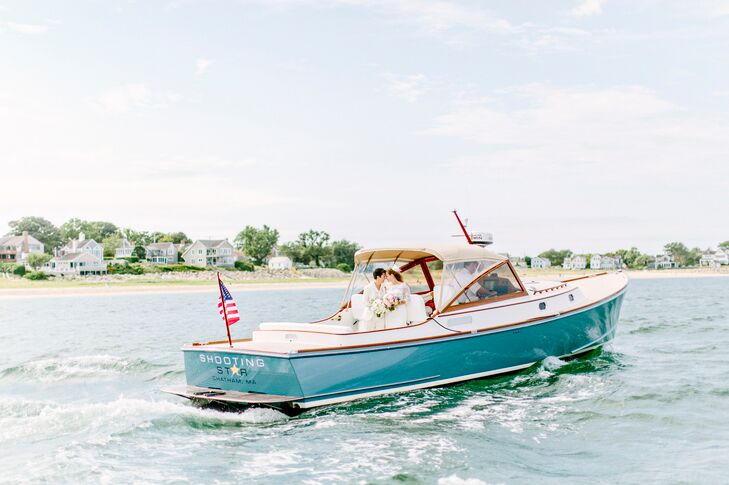 "Drawing inspiration from their seaside venue, Louise and Katie pulled off a beach-nautical-chic affair with a color palette of pale pink, cream, green and shades of navy and hydrangea blue. ""We wanted a classic, yet light, beachy ambiance that would reflect the uplifting feel of the day,"" says Louise and Katie."