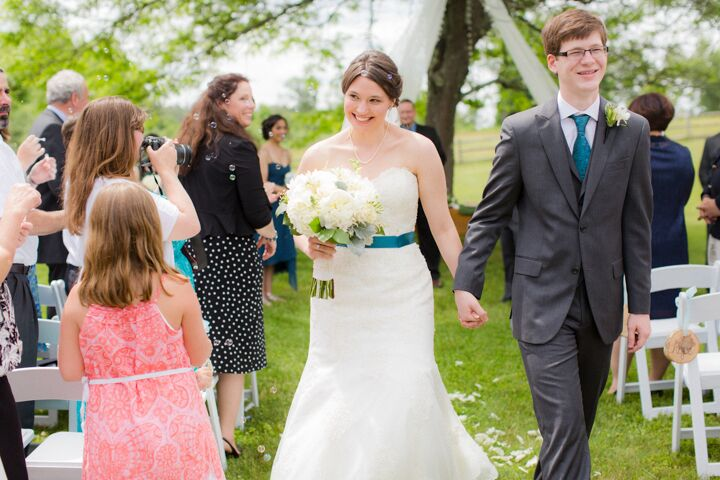 """""""I had wanted a mix of rustic and elegant, so we had a simple and traditional ceremony outside in a meadow with a big tree, and our reception was indoors in a beautiful historic inn,"""" Hannah says."""