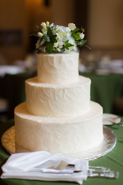 """""""We had beef, salmon and pumpkin ravioli,"""" Hannah says. """"Since tomatoes were in season and we both love tomatoes, lots of our appetizers incorporated them, like bruschetta."""" For dessert, they ate a beautiful white wedding cake with a floral cake topper."""