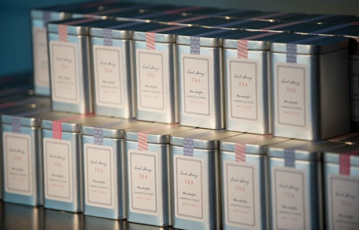 The couple gave guests metal tins filled with Earl Grey tea bags. I thought the tea would be a nice but subtle nod to our Chinese heritage, explains Marietta. Custom labels and patterned washi tape gave the tins a personalized look.