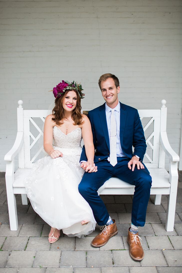 Andi paired her strapless gown with a bohemian headpiece, while Eric opted for a sharp navy suit.
