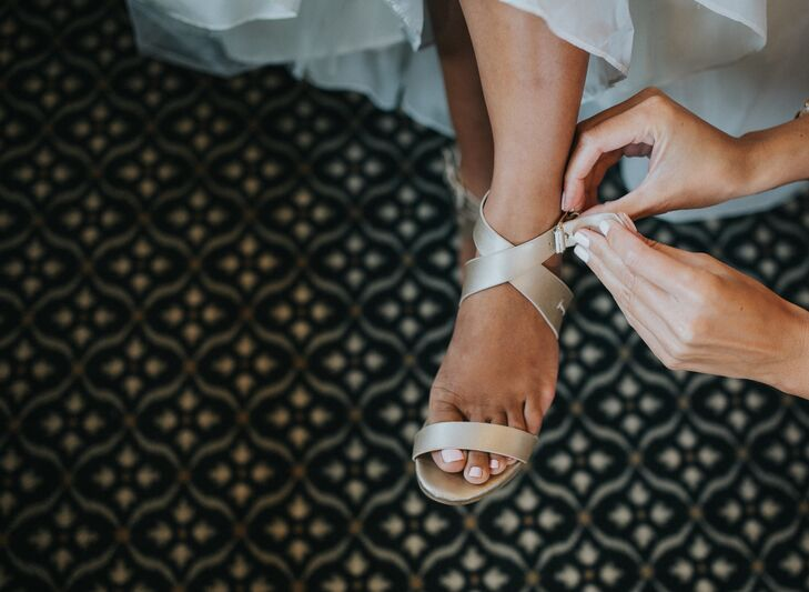 Josephine wanted stylish sandals that wouldn't catch in the slats of the dock during the ceremony at Detroit Yacht Club in Detroit, Michigan.