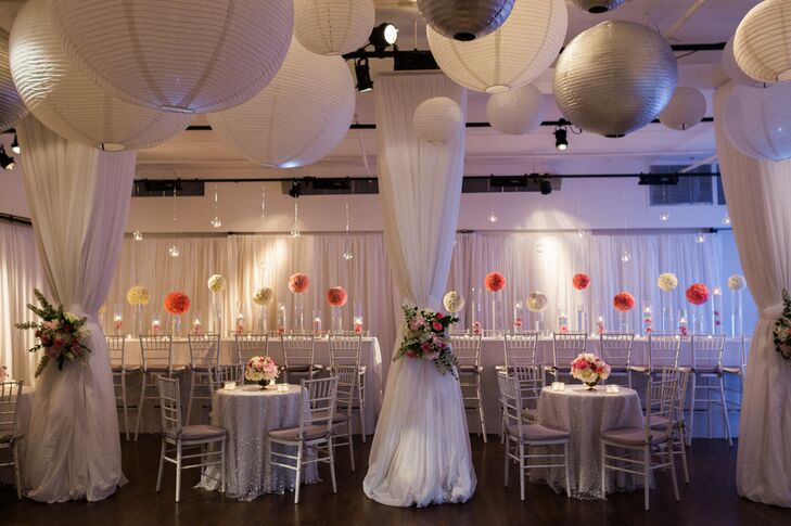 """White paper lanterns and lush pink and white hydrangea centerpieces added a modern twist to the couple's restaurant reception at the Upper Crust in New York, New York. """"We chose the venue because it was a blank canvas that we could design and make into anything we wanted,"""" Cecilia says. """"We also love the West Village, and it was a perfect blend of indoors and outdoors."""""""