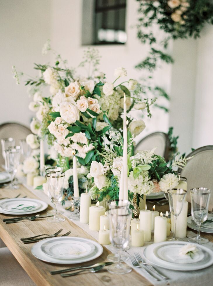Tall floral arrangements and a spread of candles