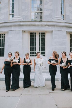 Elegant Bridesmaids Wearing Long Black Gowns