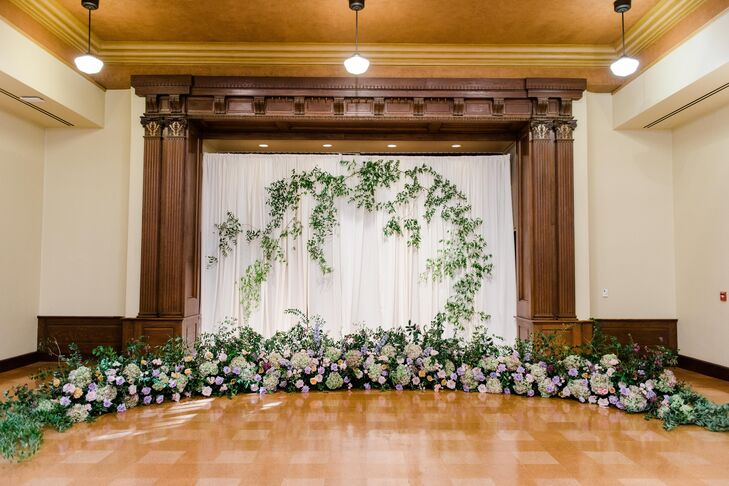 Hanging Greenery Ceremony Backdrop with Wildflower Installation