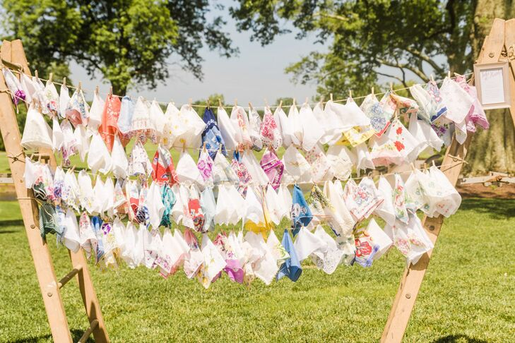 On their way into the outdoor ceremony, guests were invited to take a vintage handkerchief, to catch happy tears, that Mollie sourced online.