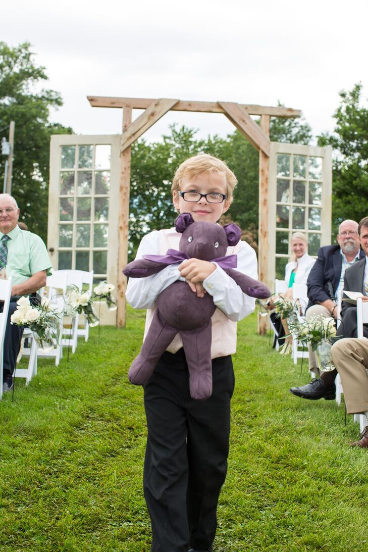 The ring bearer carried a little purple ring bear down the aisle, which was handmade by Haley's great-aunt. The boy kept his look simple with black slacks and white button-down.