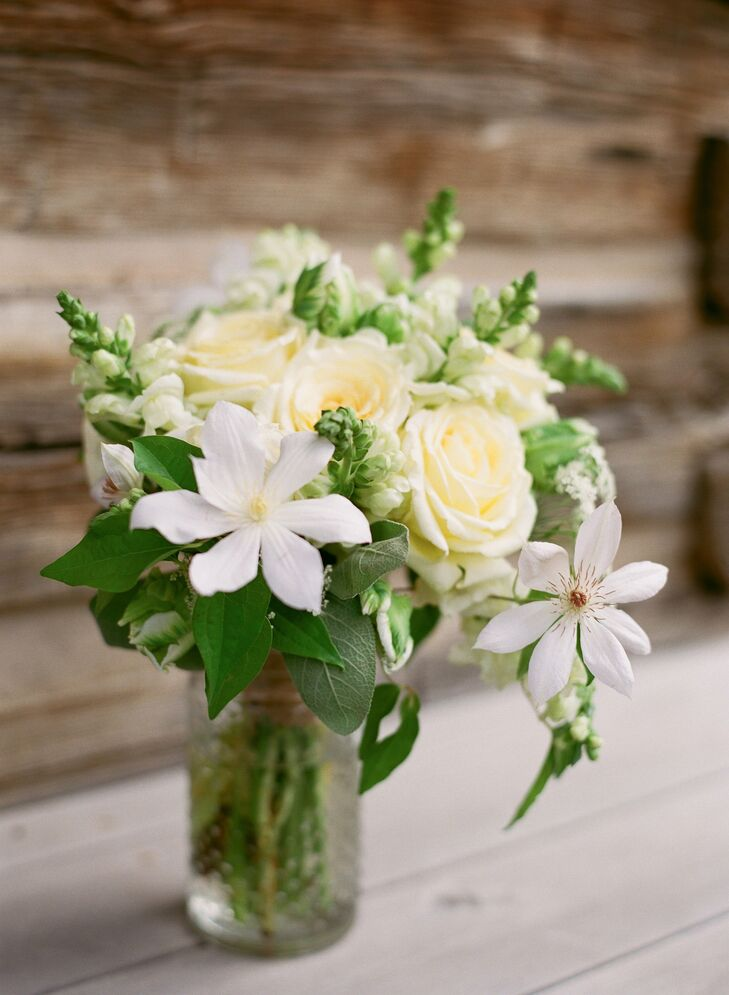 The bride's natural bouquet was made of ivory roses, snapdragons and clematis with lush greenery.