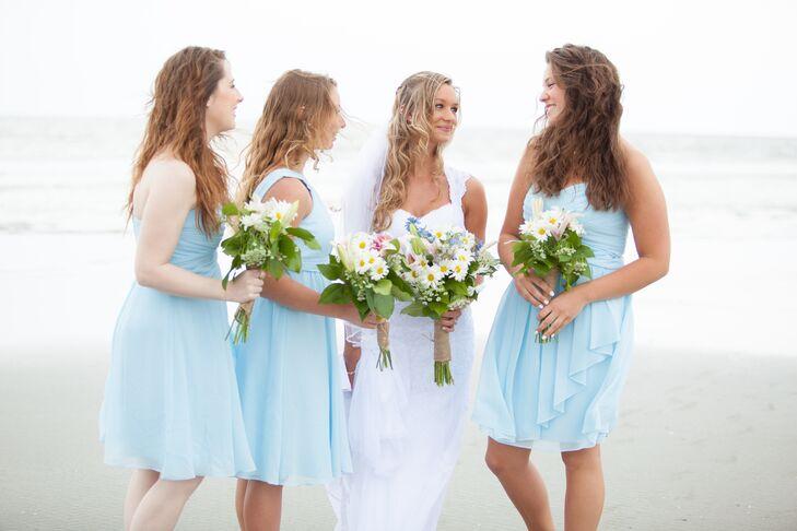 dce7ca891c Kayt's three bridesmaids wore short capri blue dresses, wavy beach hair and  no shoes for