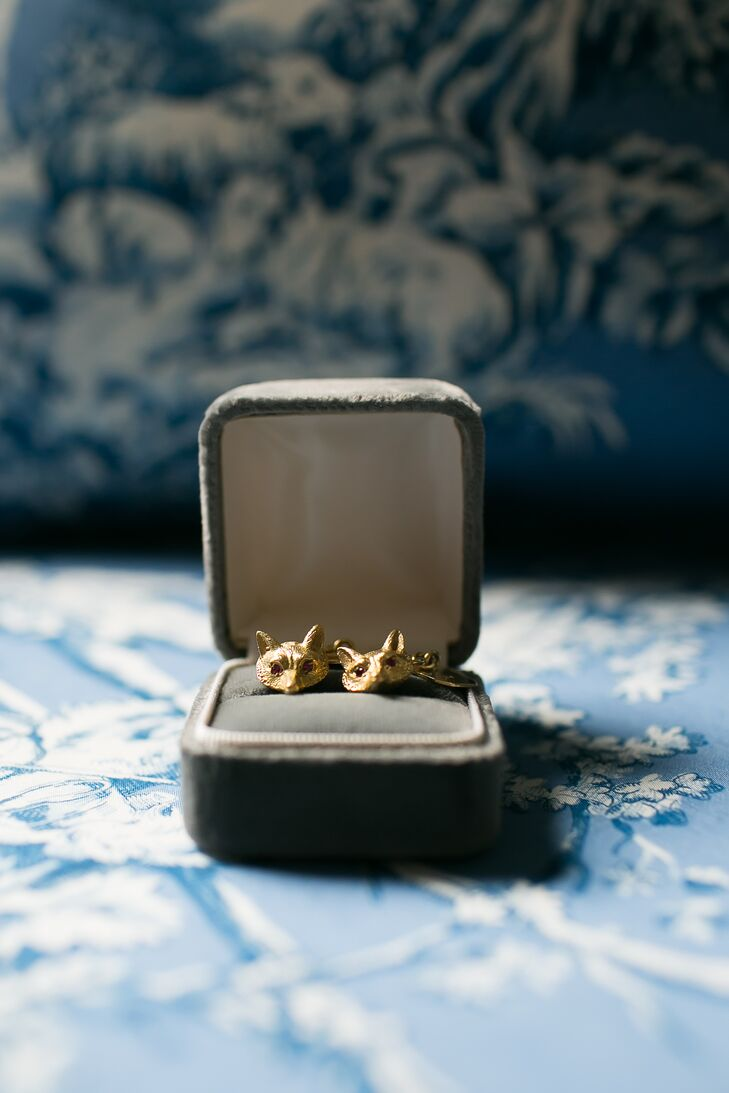 """Mike paired his custom blue suit with something special: gold, fox-inspired cuff links. """"My dad's father loved the sport of fox hunting, and the farm has fox emblems all around,"""" Cam says. """"In honor of him, the fox symbol was a bit of a theme for our wedding."""""""
