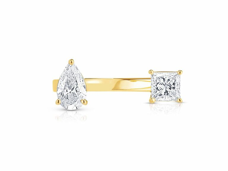 two stone ring in open setting with pear shaped diamond and cushion cut diamond