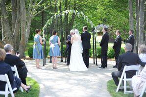 Flowery Wedding Arch at Springtime Ceremony
