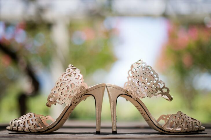 Gia walked down the aisle in a pair of champagne colored heels with a cool cut-out design.