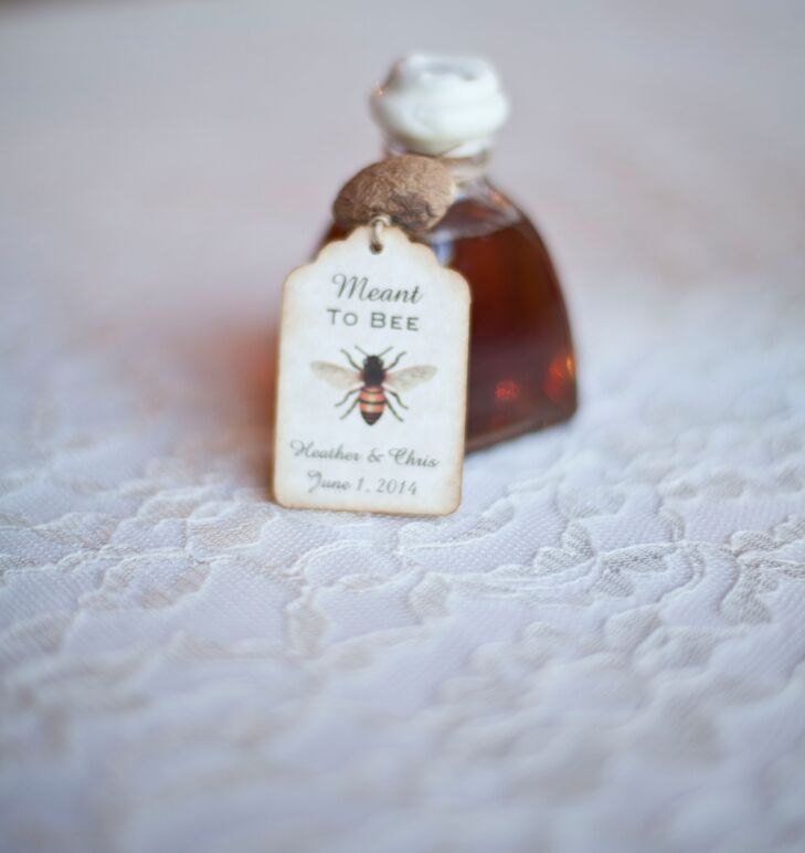 """As favors, Heather and Chris gave their guests small jars of honey with tags that read """"Meant to Bee."""""""