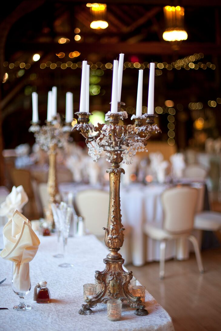 The reception decor included ornate gold candelabras that perfectly suited the castle venue.