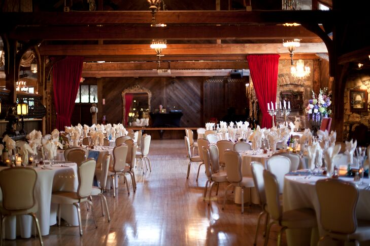 The reception was held indoors at Bill Miller's castle. The dining tables were decorated simply and elegantly with white linens and blue table runners.