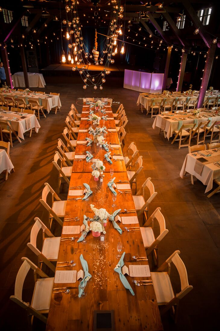 """Samantha and Ben's reception at Happy Days Lodge followed a rustic look. """"The lodge is made of dark wood, is quite large and has high, vaulted ceilings,"""" Samantha says. """"The feeling was very rustic, which we enhanced with burlap decorations, mason jars and sweet tea."""""""