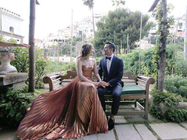 bride wears rose gold wedding dress