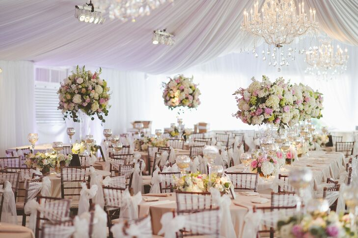 "By keeping the the color palette light with soft and fluffy floral textures, the design team created a whimsical, but that ""grand"" feeling in the reception tents."