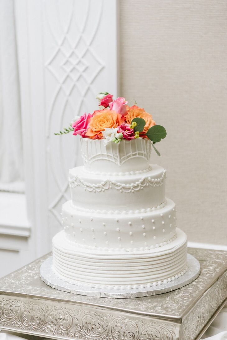 Tiered Cake with Decorative Frosting Details and Flowers