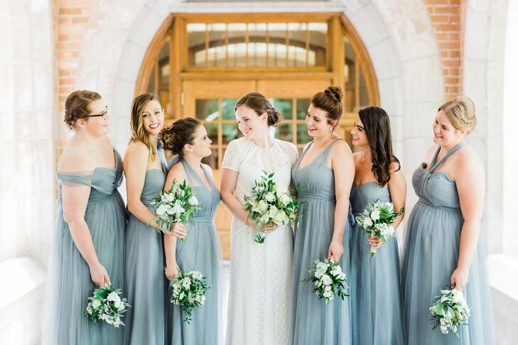 """My bridesmaids wore the Annabelle by Jenny Yoo in Mayan Blue,"" Hannah says. ""I absolutely loved the soft, dreamy look of the skirts and that each bridesmaid could adjust the neckline to make the dress her own."""