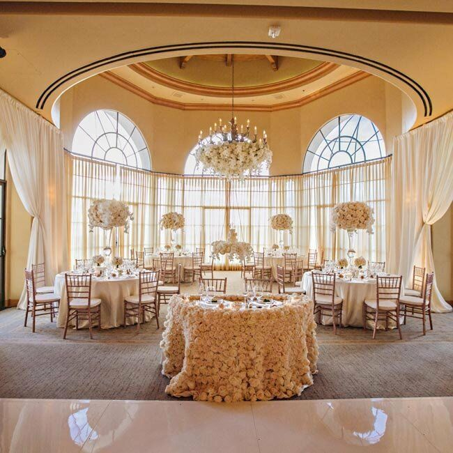 Shades of ivory and white with hints of rose gold paired perfectly with the look of the Mar Vista Ballroom. Lush bunches of flowers, a dramatically decorated chandelier and airy white fabric gave the room an enchanting, romantic quality.