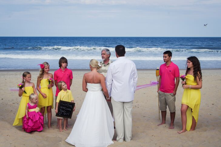 """I've always dreamed of a beach wedding: simple, barefoot and in the sand,"" Amanda says. She and Jason were married  by the water on Croatan Beach in Virginia Beach, Virginia."