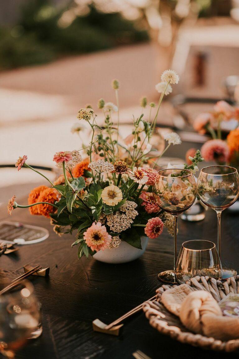 Orange zinnia floral arrangement