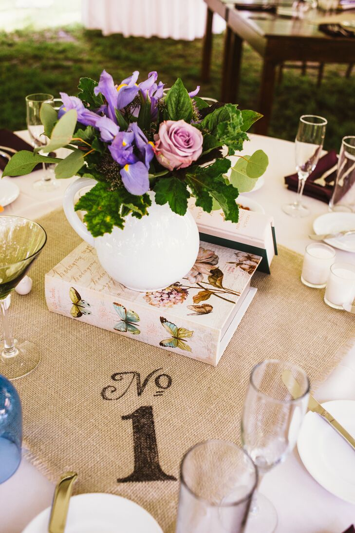 Mia's mom helped with all of the rustic DIY details including the stenciled burlap table numbers.
