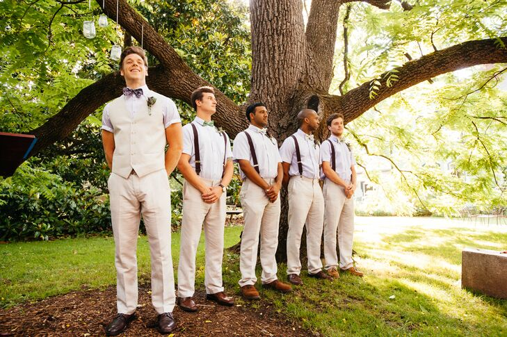 The groomsmen wore bone colored linen pants, purple short sleeve button up shirts, deep mahogany suspenders with green and purple bow ties.