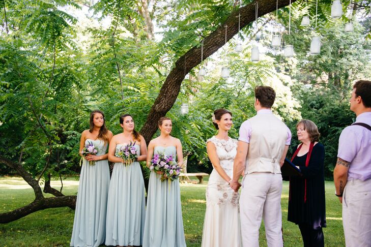 The bridesmaids wore Jenny Yoo's convertible dress in pistachio green.