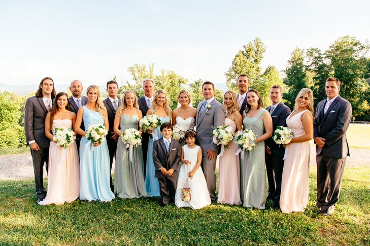 Jeff wore a custom light gray tuxedo and his groomsmen wore slightly darker Calvin Klein tuxes with ties that matched the pastel tone of the bridesmaid they were walking with.