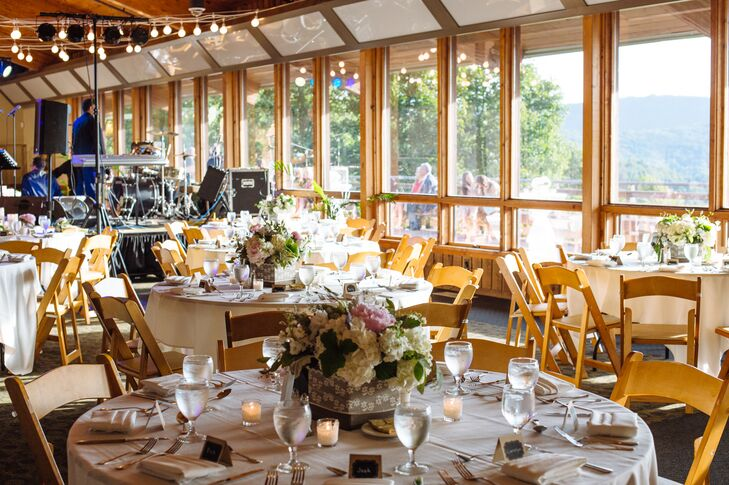 Draped fabric and hanging cafe lights softened the wood and burlap decor.