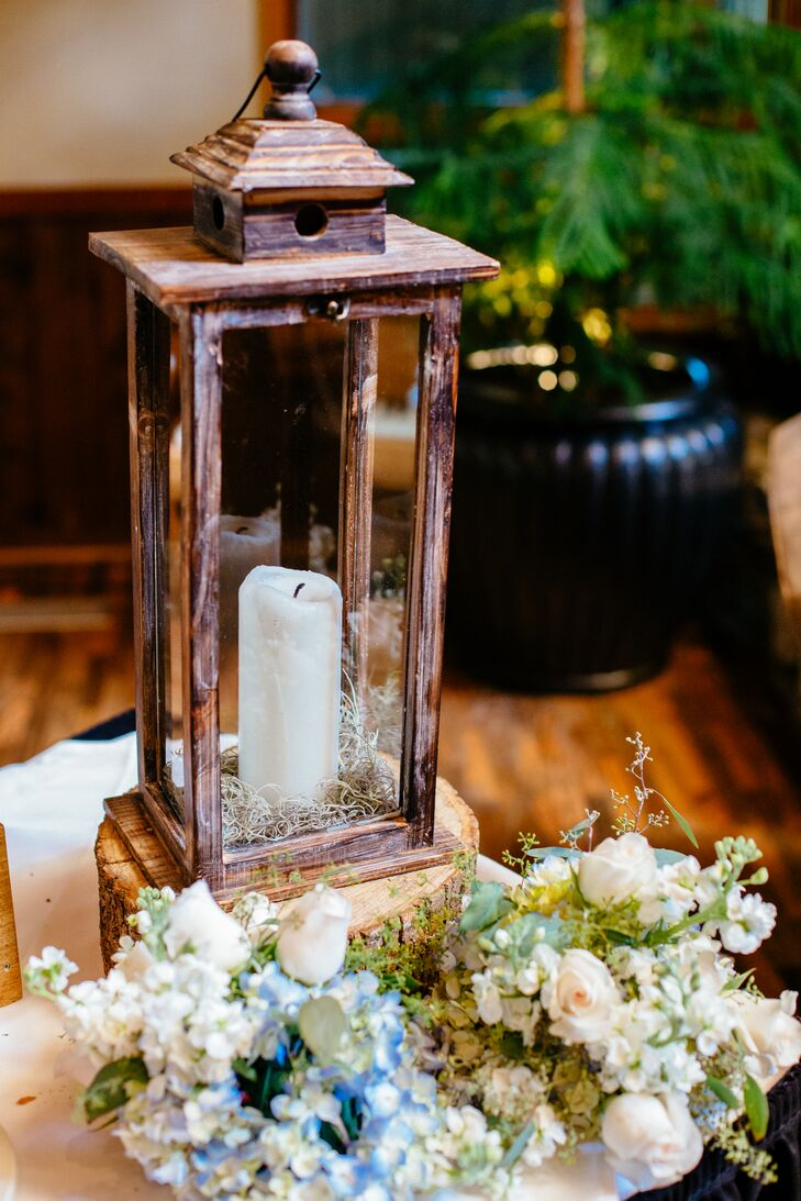 Inspired by their mountainside destination wedding, the couple went with a shabby-chic theme and decorated with wood, burlap and lace accents.