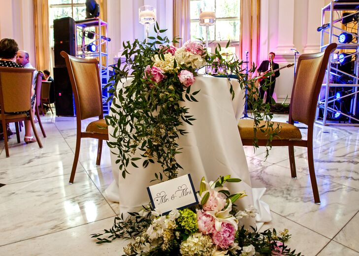 The lush flower arrangements included lilies,