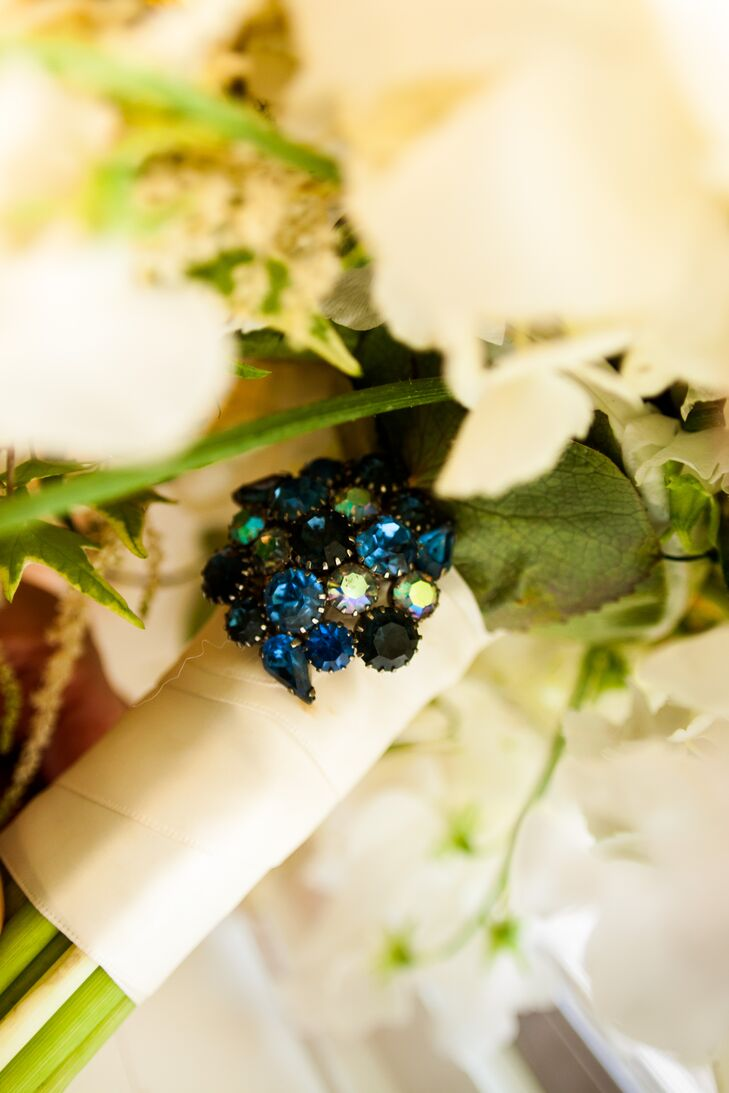 Ashley's grandmother gave her a blue crystal pin to add to her white bouquet as her something borrowed and something blue.