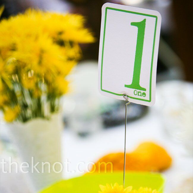 """Andrea loves bright, """"happy"""" colors, and yellow has always been one of her favorites, so she knew she wanted it incorporated into the wedding. The couple put a fun twist on black and white by adding yellow and green to the mix."""