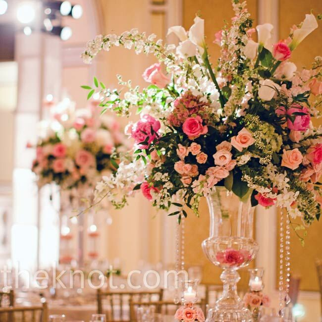 The couple's florist created tall centerpieces with sweet pink florals and hanging crystals.