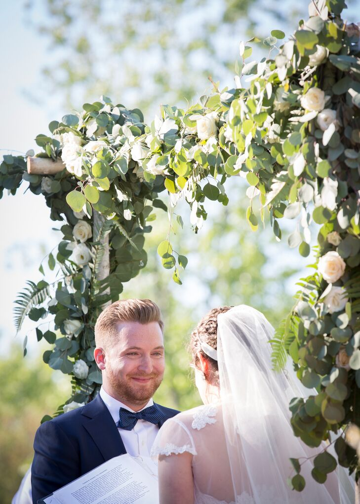 After cocktail hour, the ceremony took place outdoors on the barn's expansive lawn. Tara and Graeme exchanged vows under a chuppah designed by Stylish Blooms, a beautiful birch structure draped in garlands of eucalyptus, ferns and romantic blush roses.