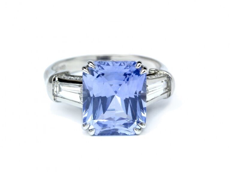 Emerald cut sapphire engagement ring with baguette diamonds