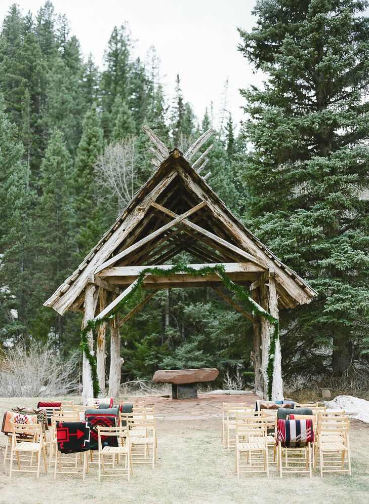 The small outdoor ceremony was held under an open-air chapel overlooking the mountainside.